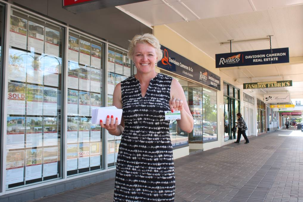 Rotary 2380 member Lauren Robertson with Why Leave Town? cards, which will see  funds flow back into Gunnedah.