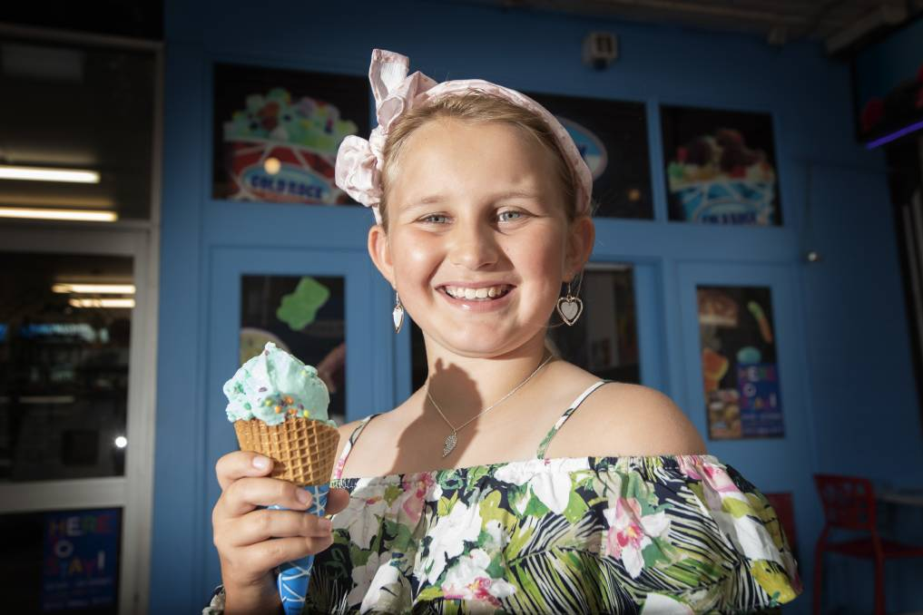 TASTY TREAT: Molly Crawley enjoys a delicious ice-cream from Cold Rock on Peel Street. Photo: Peter Hardin