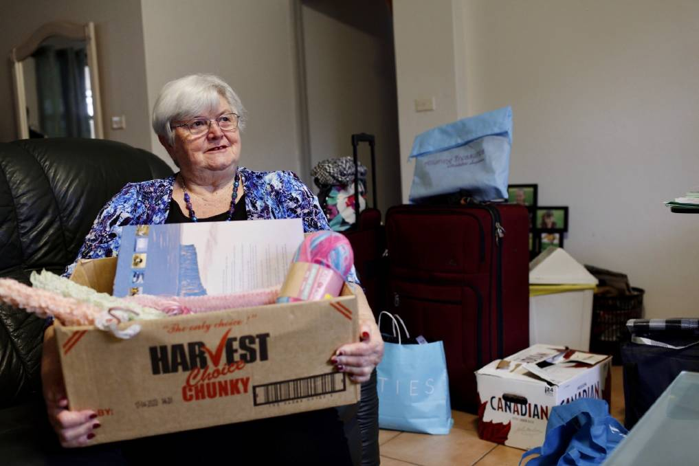 ACCOMMODATION: Housing Trust tenant Lyn Bailey packing on Thursday, ahead of a move into her newly secured property at Shellharbour. Picture: Supplied